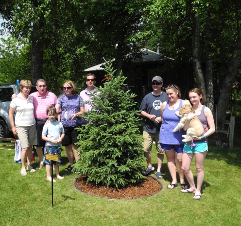 The Stroh's and the memorial tree for Steve
