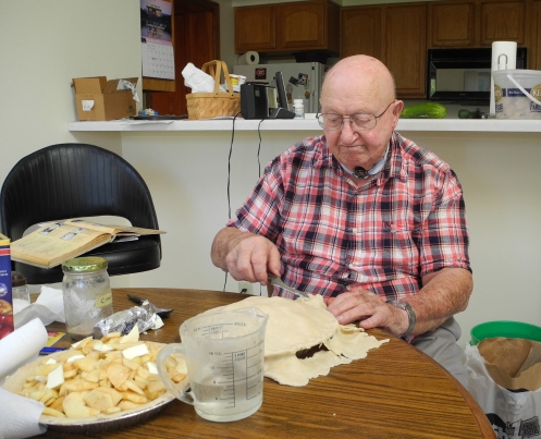 Dad putting together the first set of pies.